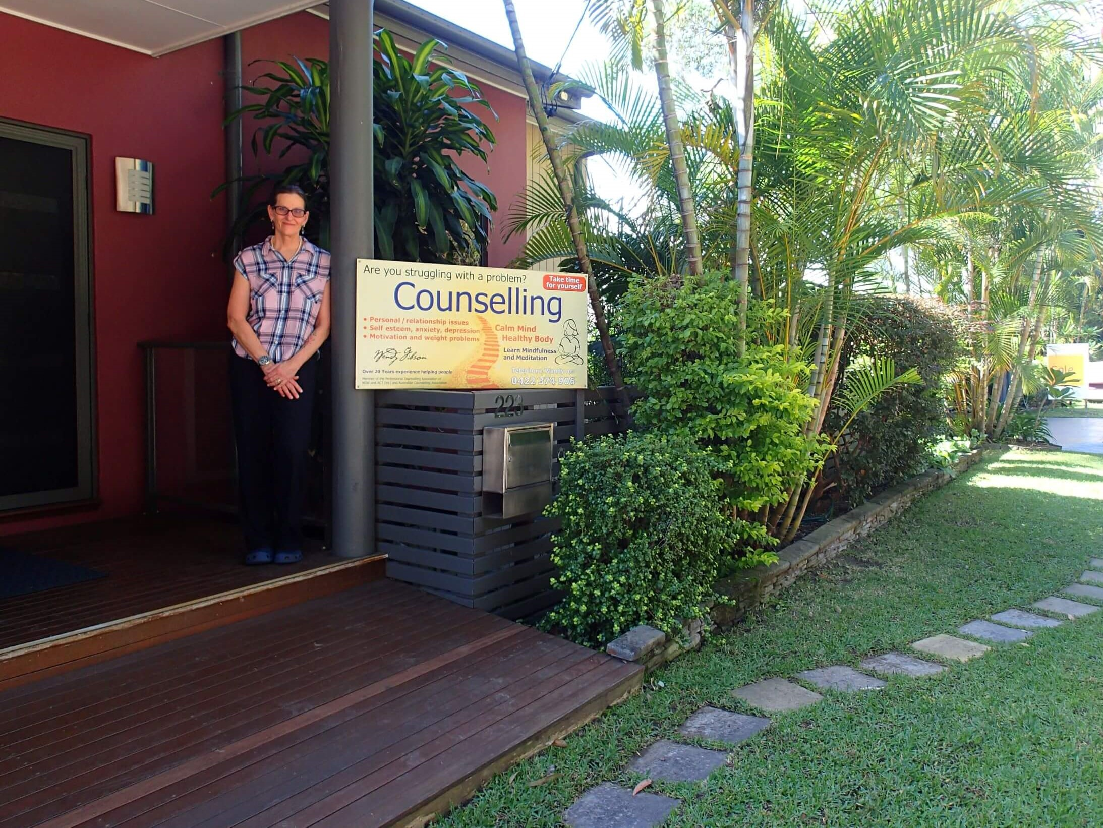 Wendy Gibson Counselling Central Coast standing at front of her practice